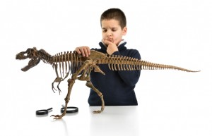 young scientist with dinosaur