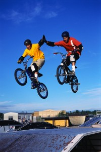 Dirt Bikers Giving High Five During Jump