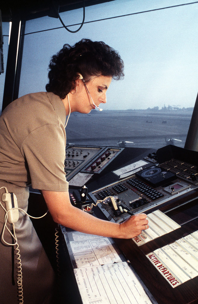 Air Traffic Controlman Third Class (ACC) Wendy Parrett list a new aircraft arrival from her local control position in the air traffic control tower at Naval Air Station North Island. Photo by PH2 Eric A. Clement