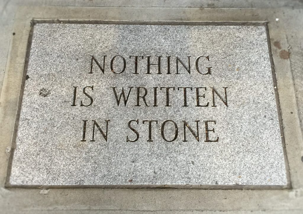 "A sign, written in stone, saying ""Nothing is written in stone"""